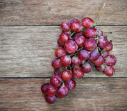 Fresh Grapes on a wooden table Stock Photos