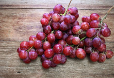 Fresh Grapes on a wooden table Royalty Free Stock Photos