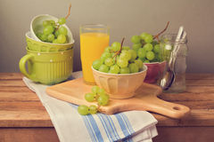Fresh grapes on wooden table Royalty Free Stock Photo