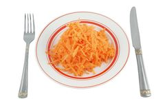 Fresh grated carrot with fork and knife Royalty Free Stock Photo