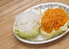 Fresh grated carrots and daikon radish Royalty Free Stock Photography