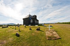 Fresh grave by stone church Stock Photography
