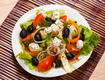 Fresh greek salad. Greek salad on a white plate royalty free stock image