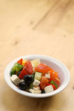 Fresh Greek Salad. On wood table with copy space Stock Image