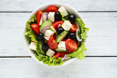 Fresh Greek salad in a bowl royalty free stock photo