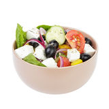 Fresh greek salad in clay bowl Royalty Free Stock Image