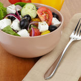 Fresh greek salad in clay bowl Royalty Free Stock Images