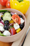 Fresh greek salad in clay bowl Stock Image