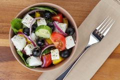 Fresh greek salad in clay bowl Royalty Free Stock Photo