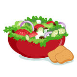 Greek salad bowl. A delicious bowl of Greek salad with fresh vegetables served with bread Stock Photography