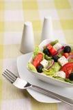 Fresh Greek salad with fork Royalty Free Stock Photos