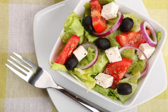 Fresh Greek salad with fork Royalty Free Stock Photo