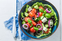 Fresh Greek salad with lettuce, cherry tomatoes and feta cheese Royalty Free Stock Photography