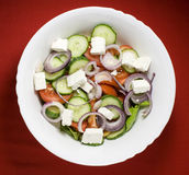 Fresh Greek salad with olive oil. Photo of a Greek fresh salad with feta cheese and olive oil Royalty Free Stock Image