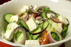 Fresh Greek salad with olive oil. Photo of a Greek fresh salad with feta cheese and olive oil Stock Images