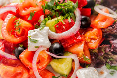 Fresh Greek salad with onion. Close up with selective focus Stock Photos