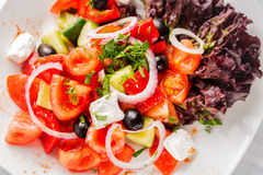 Fresh Greek salad with onion. Close up with selective focus Royalty Free Stock Photo