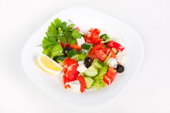 Fresh Greek salad in white bowl. Juicy fresh Greek salad in white bowl, isolated on white background Stock Images