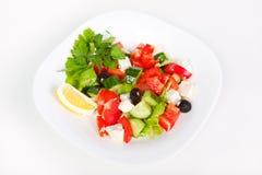 Fresh Greek salad in white bowl Stock Images