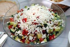 Fresh greek salad with white greek goat cheese Royalty Free Stock Photos