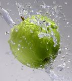 Fresh green apple. A fresh green apple with splashing water Royalty Free Stock Image