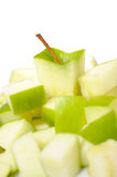 Fresh green apple cut into slices. Royalty Free Stock Images