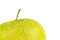 Fresh green apple with droplets of water against white background Royalty Free Stock Photo
