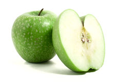 Fresh green apple with half Royalty Free Stock Photo