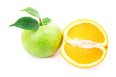 Fresh green apple and half of an orange Royalty Free Stock Photo