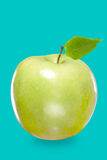 Fresh green apple isolated on blue Royalty Free Stock Photography