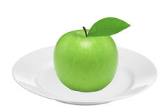 Fresh green apple with leaf on plate isolated on white Royalty Free Stock Photos