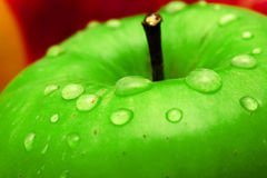 Fresh green apple macro photo Stock Photos