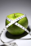 Fresh green apple with measure tape Stock Photo