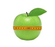 Fresh green apple and measuring tape isolated Royalty Free Stock Photography