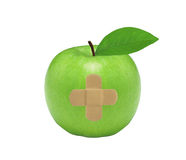 Fresh green apple with medical patch, isolated on white Stock Photos
