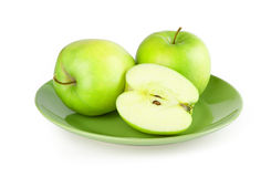 Fresh green apple on a plate Royalty Free Stock Photo