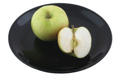Fresh green apple on a plate isolated Stock Image