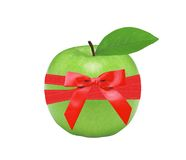 Fresh green apple and red bow isolated Royalty Free Stock Photos