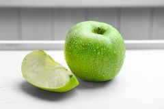 Fresh green apple and slice. On table Royalty Free Stock Photo