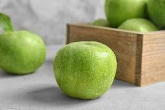 Fresh green apple with water drops. On table stock images