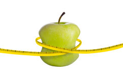 Fresh green apple on white. With measuring tape Royalty Free Stock Image