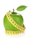 Fresh green apple with yellow measuring tape Stock Photo