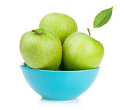 Fresh green apples in bowl Stock Images