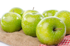 Fresh green apples on burlap bag Royalty Free Stock Photography