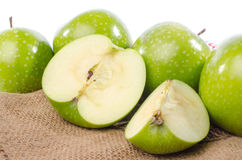 Fresh green apples on burlap Royalty Free Stock Images