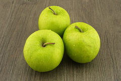 Fresh green apples on dark brown wood Royalty Free Stock Photo