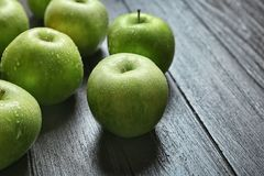 Fresh green apples. On wooden background Stock Photography