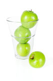Fresh green apples in glass isolated on white Royalty Free Stock Images