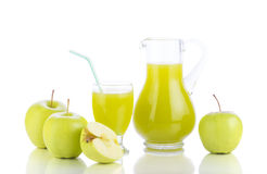 Fresh green apples, glass with juice and carafe Stock Photos