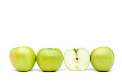 Fresh green apples iwth one sliced Royalty Free Stock Images